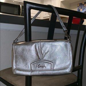 Authentic silver Coach handbag.